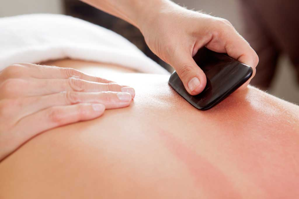 Patient receiving gua sha treatment